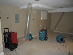 Water Damage Hutchins Vacuuming Attic