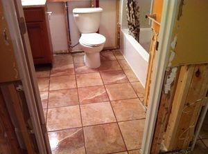 Water Damage Restoration In Downstairs Bathroom