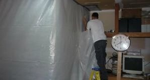 Technicians Installing Vapor Barrier For Water Damage Removal
