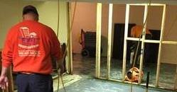 Water Damage Technicians Cleaning Carpet After A Flood