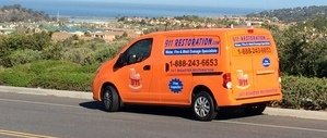 Mold Damage Restoration Van Driving To Job Location