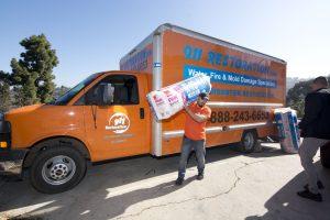 911-restoration-van-man-water-damage-services