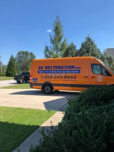 Water Damage Restoration Van At A Residential Property